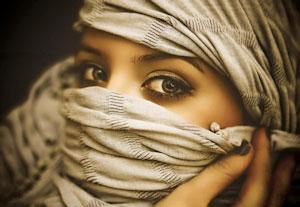 Une courtisane arabe voilée
